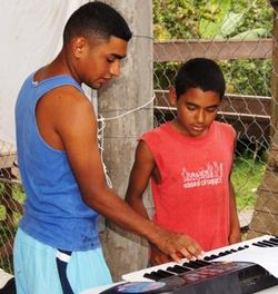 José Teaching Piano Lessons